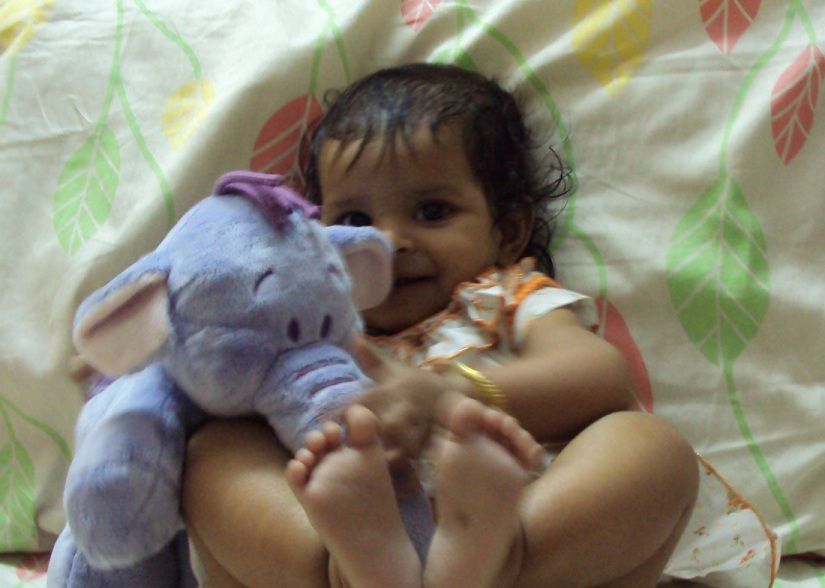 Playing with her ganesha
