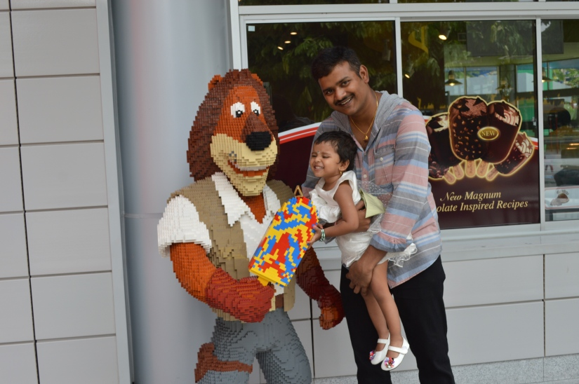 trying to snatch ice cream from lego lion